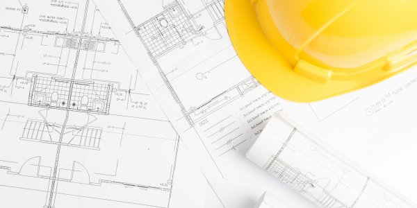 blueprints with a yellow hardhat