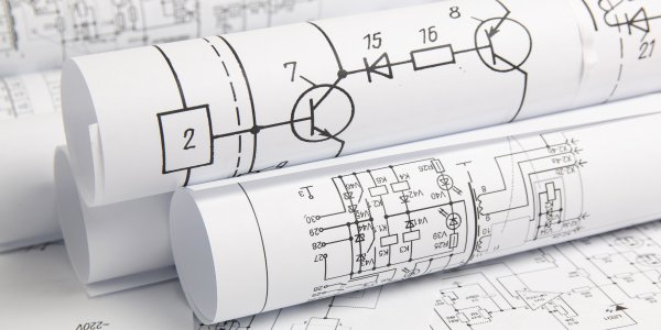 rolls of blueprints with electrical drawings