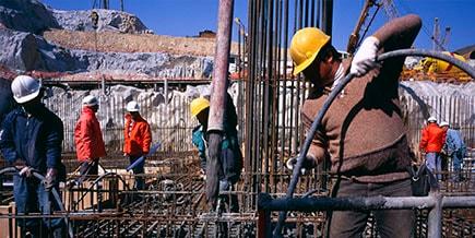 construction workers handling prefab