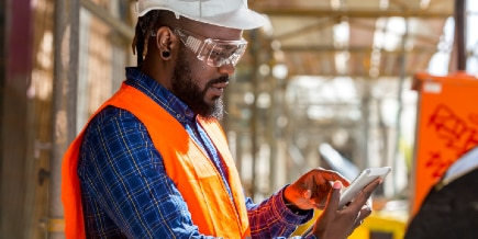 Engineer using a tablet at a construction site