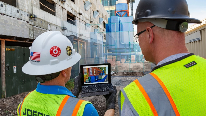 Construction workers reviewing virtual design