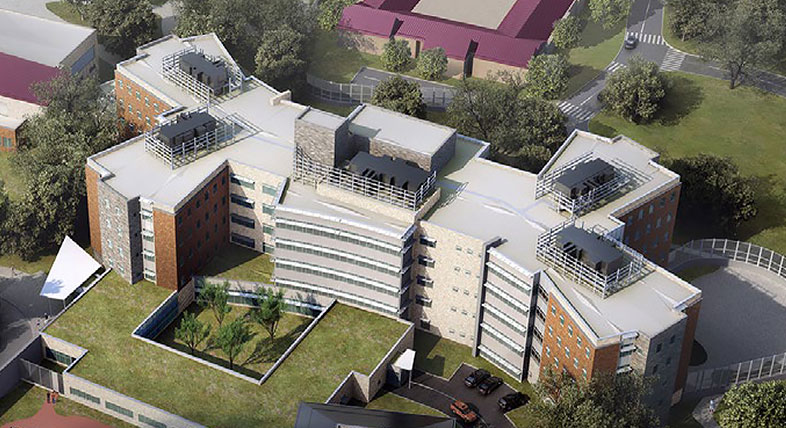 A digital model of a multi-story building complex with green landscape and roads