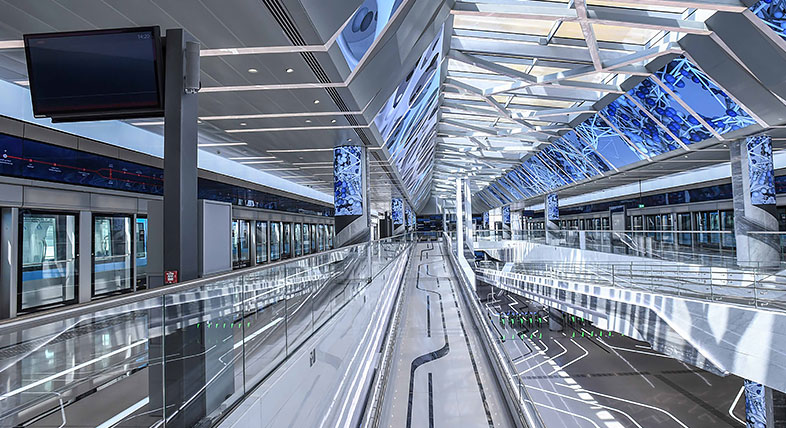 A digital model of a large transportation hub with walking pathways