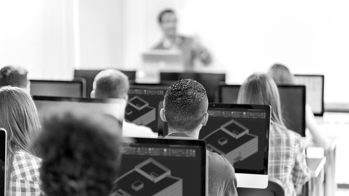 students in classroom learning AutoCAD software