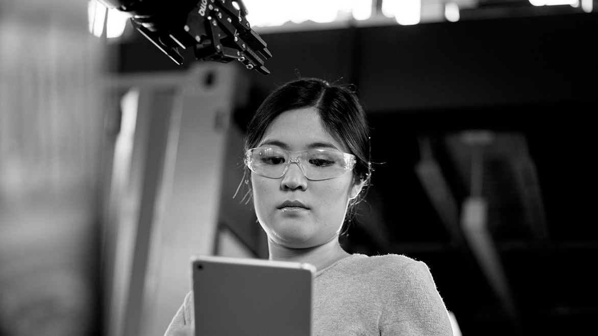 woman looking at CAD drawing on tablet