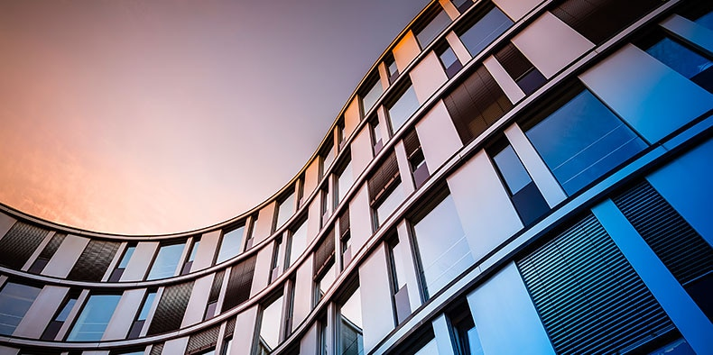 Glass facade of a modern office building in Hamburg, Germany.