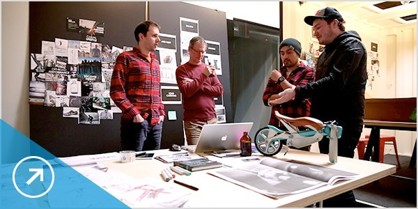 Team members collaborate on a bicycle design
