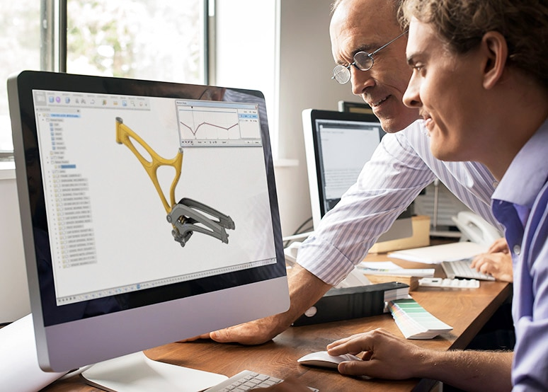 Two designers review a project in Fusion 360 cloud CAD software