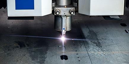Laser cutter at work cutting metal