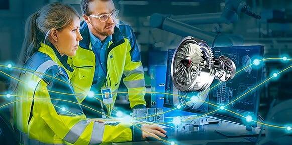 两个人使用计算机设计和制造喷气发动机。