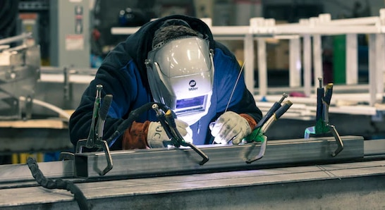 welder working on machine