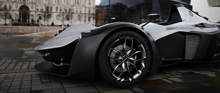 View of high-performance tire on a futuristic, sleek black sports car