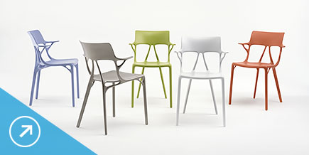Five modern-styled, molded chairs of varying colors