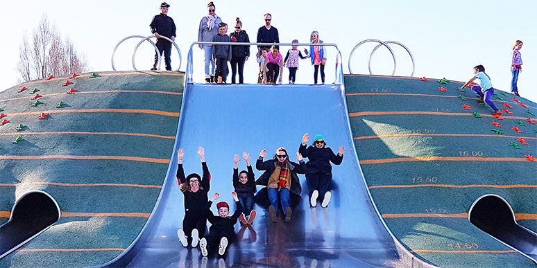 Children playing on a slide