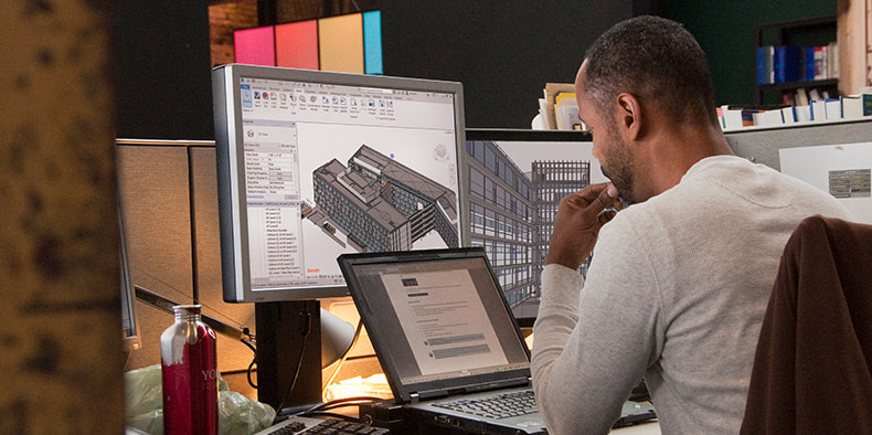 Man working with Revit on a computer