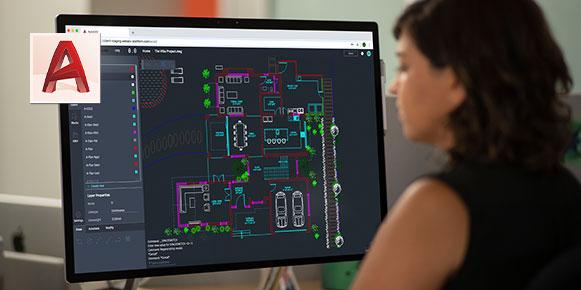 Woman studying AutoCAD network map on computer screen