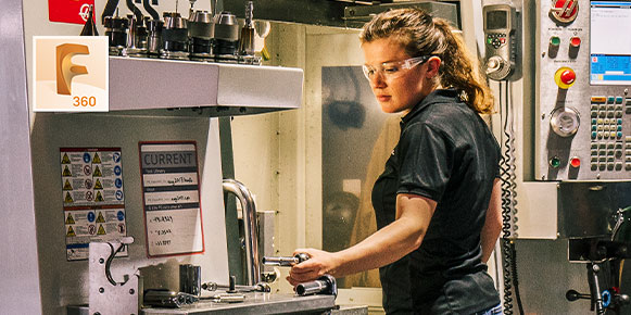 Woman with safety glasses working in machine shop