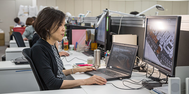 Woman using software on a computer in an office environment