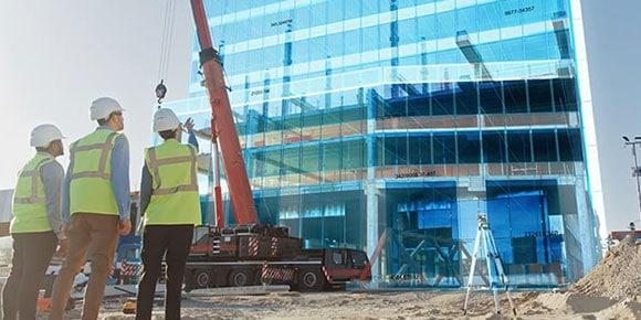 Construction workers at a skyscraper job site
