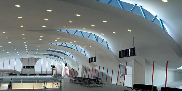 Large, white, modern transportation terminal without people