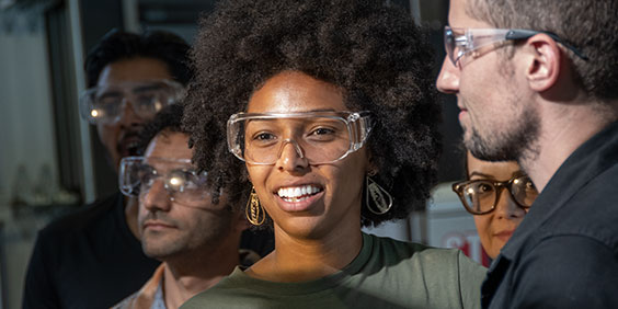Smiling woman wearing safety glasses