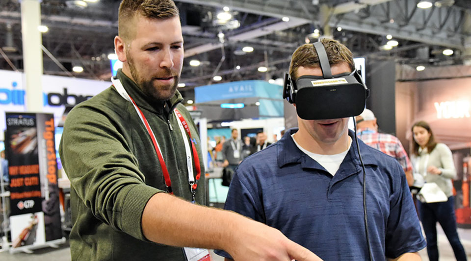Erik Lambrecht viewing the latest Revit model in virtual reality with Eric Posey