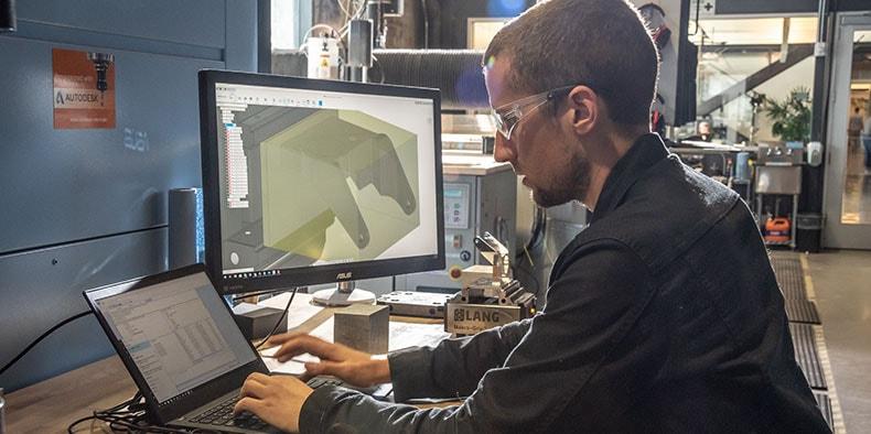 Man working in CNC machine shop
